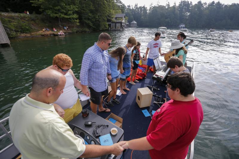 Members of the Clayton First United Methodist Church pray in 2015 during a service on a lake in Lakemont, Ga. Catholics and Methodists can learn from one another, Pope Francis says. (CNS photo/Erik S. Lesser)