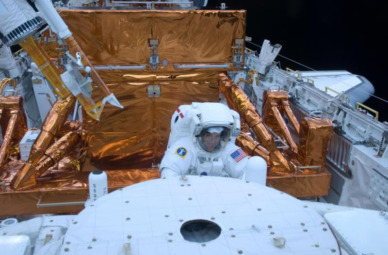 Astronaut Mike Massmino services the Hubble Space Telescope in the cargo bay of the space shuttle Atlantis May 15, 2009. Massimino, who is Catholic, said that seeing Earth's beauty from orbit confirmed how great God's love is. (CNS photo/courtesy NASA)