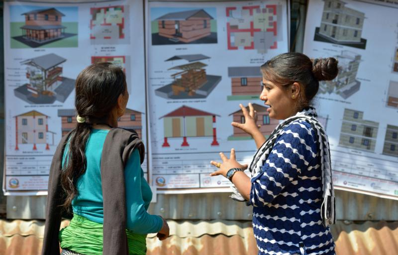A volunteer in Makaising, Nepal, describes new construction options March 9. April 25 marks the one-year anniversary of the magnitude-7.8 earthquake that struck the Himalayan nation, killing more than 9,000 people. (CNS photo/Paul Jeffrey)