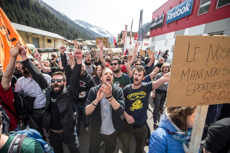 People demonstrate April 3 against the Austrian government's planned reintroduction of border controls at the Brenner Pass in Austria. Austrian church leaders have criticized their government for rebuilding border controls in a bid to keep out refugees arriving from Greece and Italy. (CNS photo/Jan Hetfleisch, EPA)