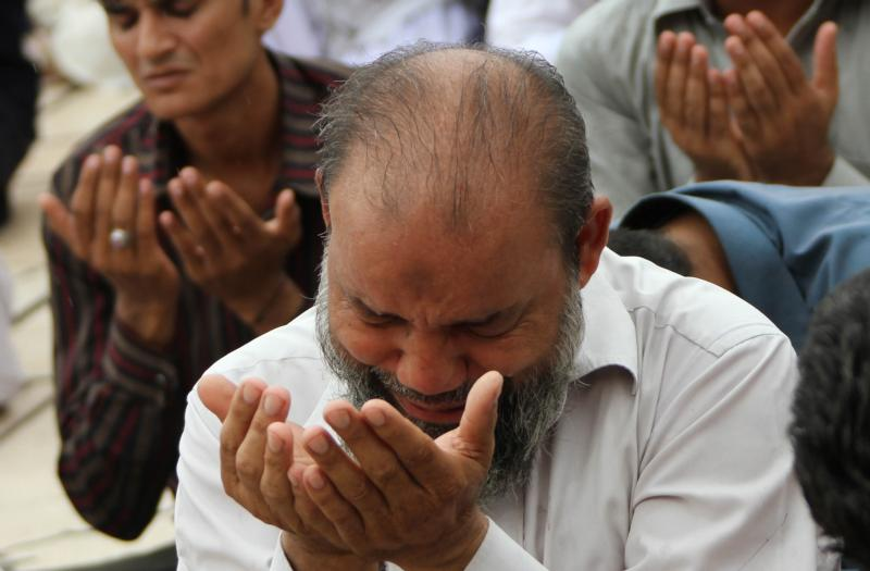 Pakistani Muslims pray during Ramadan in Karachi. Church officials in Pakistan have backed a government plea to the international community not to demonize all Muslims because of acts of terrorism committed by a few extremists, reported ucanews.com. (CNS photo/Rehan Khan, EPA)