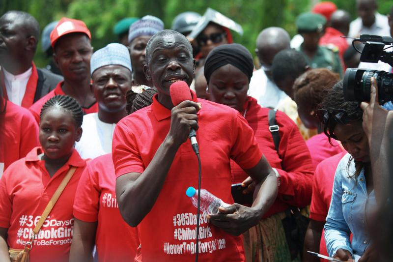 Nigerian's attend a Bring Back Our Girls protest April 14 outside the presidential villa in Abuja. Two Nigerian bishops are calling on  the government to hasten efforts to free more than 200 school girls abducted by insurgents in 2014. (CNS photo/EPA)