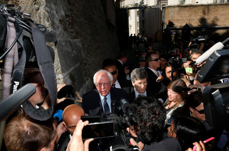 """Sen. Bernie Sanders, D-Vt., a U.S. presidential candidate, speaks to media outside the Vatican after delivering an address at a conference on Catholic social teaching April 15. The Vatican conference was dedicated to St. John Paul II's 1991 social encyclical """"Centesimus Annus"""" and was sponsored by the Pontifical Academy of Social Sciences and the Institutute for Advanced Catholic Studies. (CNS photo/Paul Haring)"""