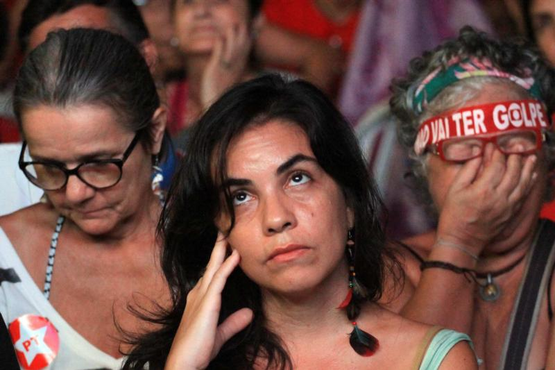 Supporters of Brazilian President Dilma Rousseff react in Rio de Janeiro as the Chamber of Deputies opened impeachment proceedings against her April 17. (CNS photo/Luiz Eduardo Perez, EPA)