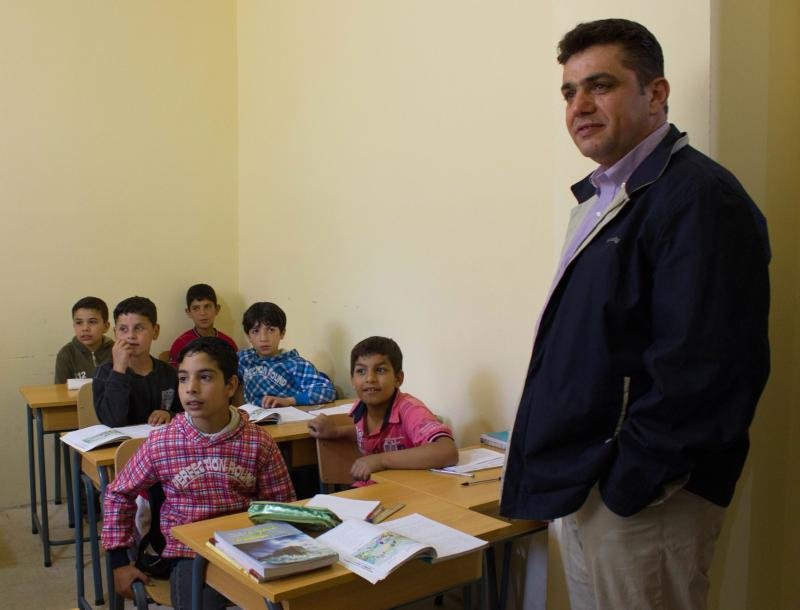"Father Nawras Sammour, Jesuit Refugee Service's Syria director, visits the JRS school  for Syrian children in Lebanon's Bekaa Valley in 2013. With a campaign called ""Mercy in Motion,"" JRS is trying to raise $35 million this year so that by 2020 it can educate an additional 100,000 refugees per year. (CNS photo/Zerene Haddad, courtesy JRS)"