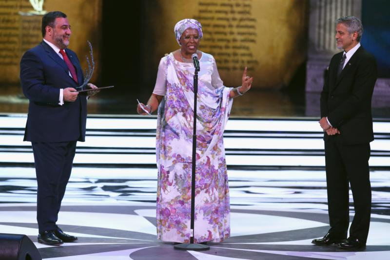 Marguerite Barankitse, a Catholic woman from Burundi, speaks April 24 after being awarded the Aurora Prize in Yerevan, Armenia. Also pictured are Aurora Prize co-founder  Ruben Vardanyan and U.S actor George Clooney. (CNS photo/Andreas Rentz, Getty Images courtesy Aurora Prize)