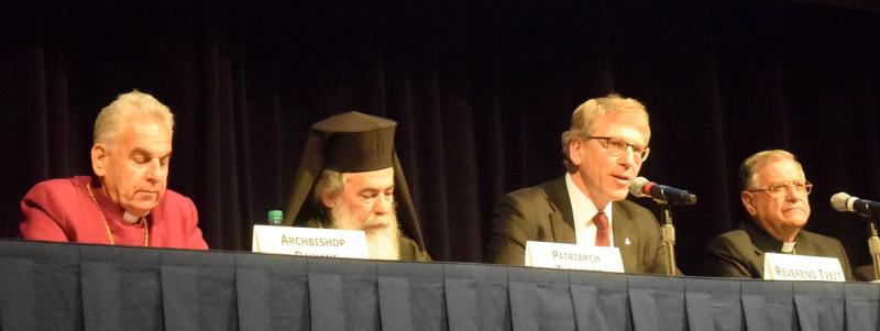 """Speakers are seen on a panel April 19 during the """"Pursuing Peace and Strengthening Presence: The Atlanta Summit of Churches in the USA and the Holy Land"""" in Atlanta. Pictured are Archbishop Suheil Dawani of the Episcopal Diocese of Jerusalem; Greek Orthodox Patriarch Theophilos III of Jerusalem; the Rev. Olav Fykse Tveit, general secretary of the World Council of Churches; and Latin Patriarch Fouad Twal of Jerusalem. (CNS photo/courtesy  Rev. Mitri Raheb)"""