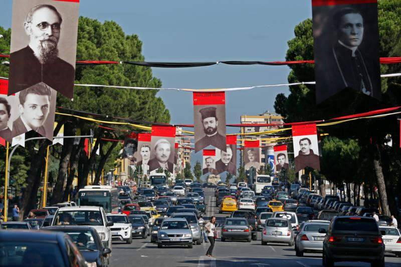 Photographs of Albanian priests killed during the former communist regime hang in the main boulevard of Tirana, Albania, Sept. 17, 2014. (CNS photo/Armando Babani, EPA)