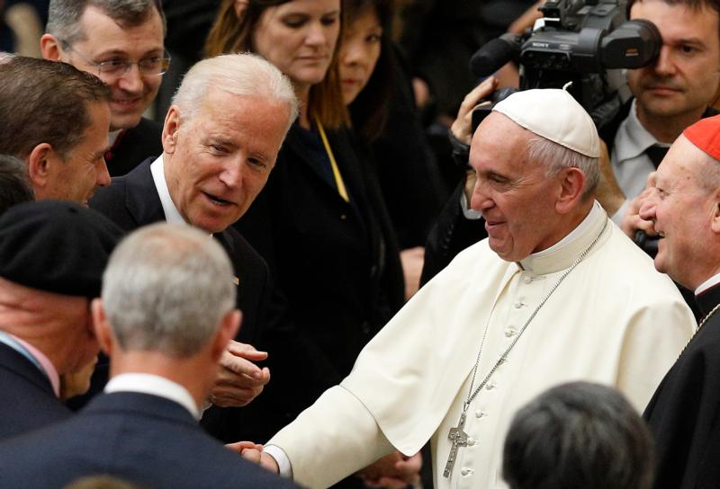 U.S. Vice President Joe Biden gestures as he meets Pope Francis after both leaders spoke at a conference on adult stem cell research at the Vatican April 29. (CNS photo/Paul Haring)