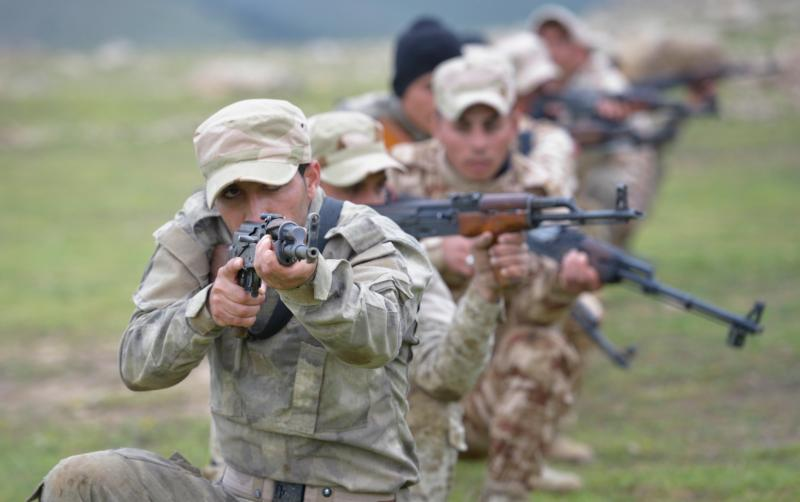 Members of the Nineveh Plain Protection Units train April 12 at their base near Alqosh, Iraq. The Assyrian militia group was formed by Christians displaced by the Islamic State group in 2014. Members hope to take back their homeland and make it a semi-autonomous province within Iraq. (CNS photo/Paul Jeffrey)