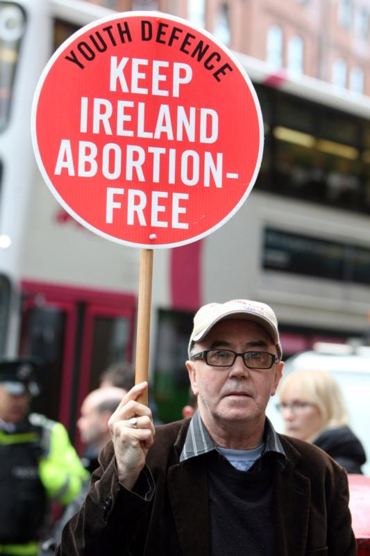 "A pro-life supporter demonstrates in 2012 outside the Marie Stopes clinic in Belfast, Northern Ireland. The Catholic bishops of Northern Ireland have described as ""profoundly disquieting"" a ruling by the High Court that the region's ban on abortion in all but very limited circumstances breaches human rights legislation. (CNS photo/Paul Mcerlane, EPA)"