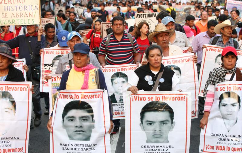 Parents of 43 missing Mexican students of the Ayotzinapa teachers' college near Chilpancingo, Mexico, participate in a  2015 protest in Mexico City. (CNS photo/Mario Guzman, EPA)