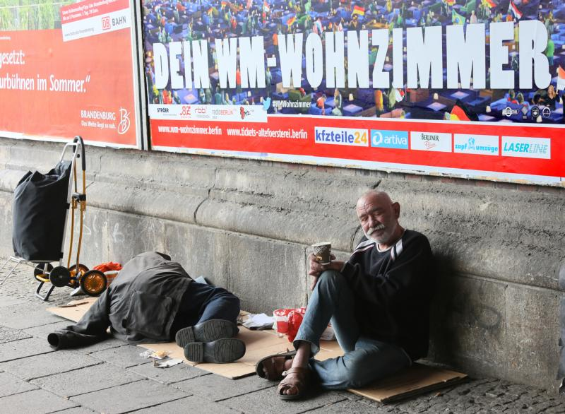 Homeless people are seen in 2014 under a bridge in Berlin. Pope Francis will welcome several thousand homeless and vulnerable people from all over Europe when they make a pilgrimage to Rome in November. (CNS photo/Stephanie Pilick, EPA)