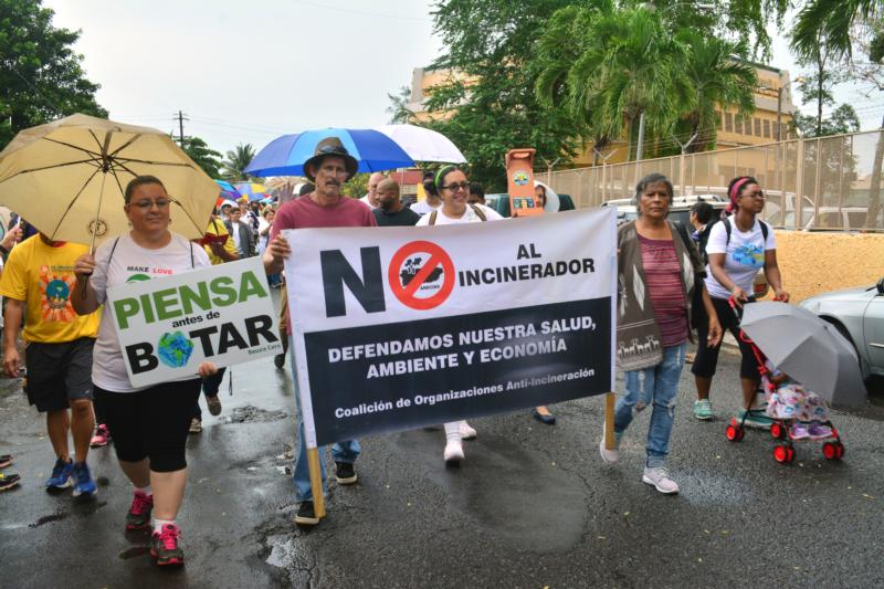 "People carry banners during an April 30 march in Catano, Puerto Rico, to raise awareness about climate change. Members of several Catholic groups joined representatives of more than 30 organizations for the march to ""raise awareness and call for immediate action"" to preserve the environment and limit climate change. (CNS photo/Wallice J. de la Vega)"