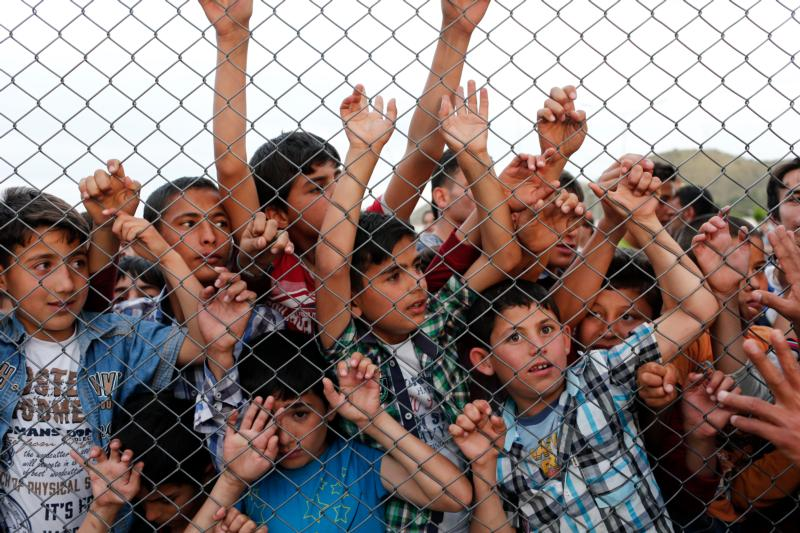 Syrian children stand at a fence April 23 at a refugee camp near Gaziantep, Turkey. Catholics should protest against immigration policies that put the lives of children at risk, said Cardinal Vincent Nichols of Westminster, England. (CNS photo/Sedat Suna, EPA)