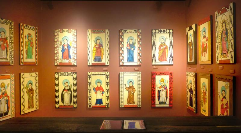 "Folk art paintings of 19 Pueblo patron saints are seen in the ""We Are Of This Place: The Pueblo Story"" exhibit April 19 at the Indian Pueblo Cultural Center in Albuquerque, N.M. (CNS photo/Zita Fletcher)"