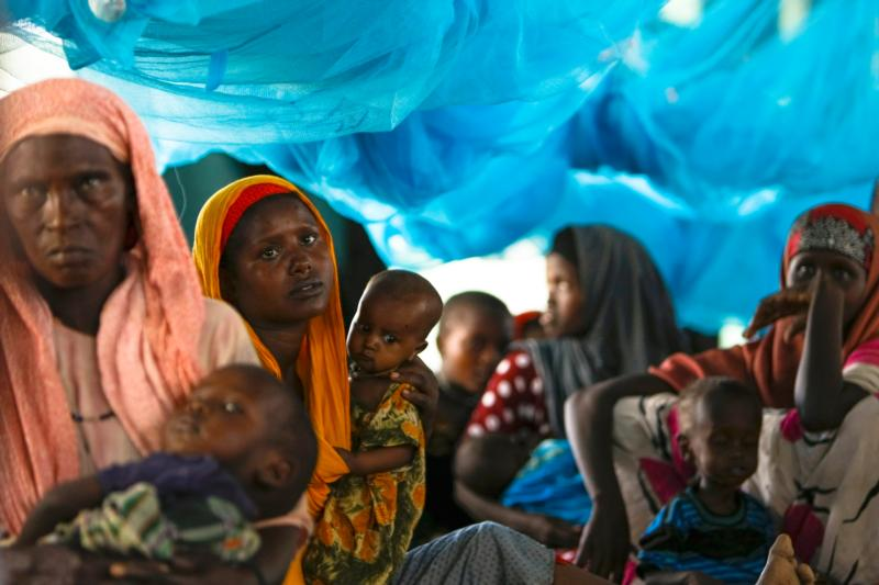 Somali refugees sit inside a tent in 2011 at the Ifo Extension refugee camp in Dadaab, Kenya, across the border from Somalia. Jesuit Refugee Service has urged Kenya to reconsider its plans to close camps that host hundreds of thousands of Somali and South Sudanese refugees.(CNS photo/Dai Kurokawa, EPA)