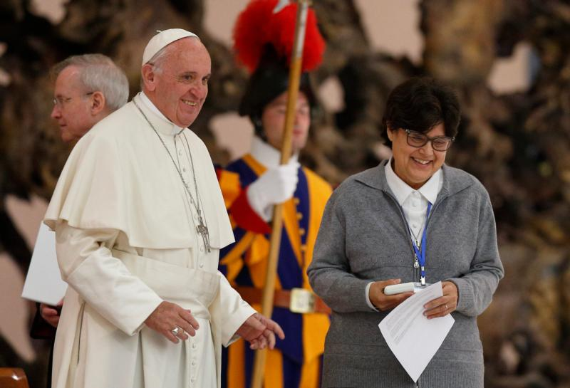 Pope Francis greets Sister Carmen Sammut,  a Missionary Sister of Our Lady of Africa and president of the International Union of Superiors General, during an audience with the heads of women's religious orders in Paul VI hall at the Vatican May 12. During a question and answer session with members of the IUSG, the pope indicated his willingness to establish a commission to study whether women could serve as deacons. (CNS photo/Paul Haring)