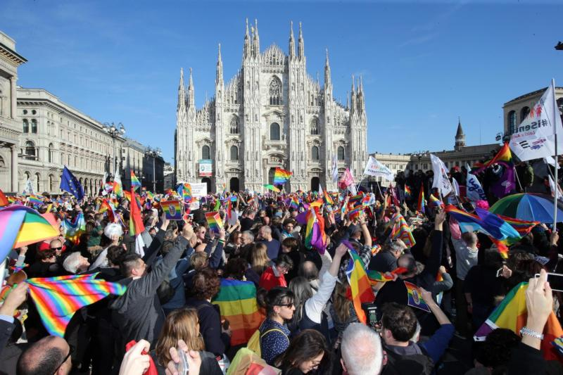 Demonstrators take part in a protest for gay rights in late February outside Italy's Milan Cathedral. The Italian government's approval of a controversial bill that grants legal recognition to non-married heterosexual and homosexual couples is a defeat for democracy and family life, an Italian bishop said. (CNS photo/Matteo Bazzi, EPA)
