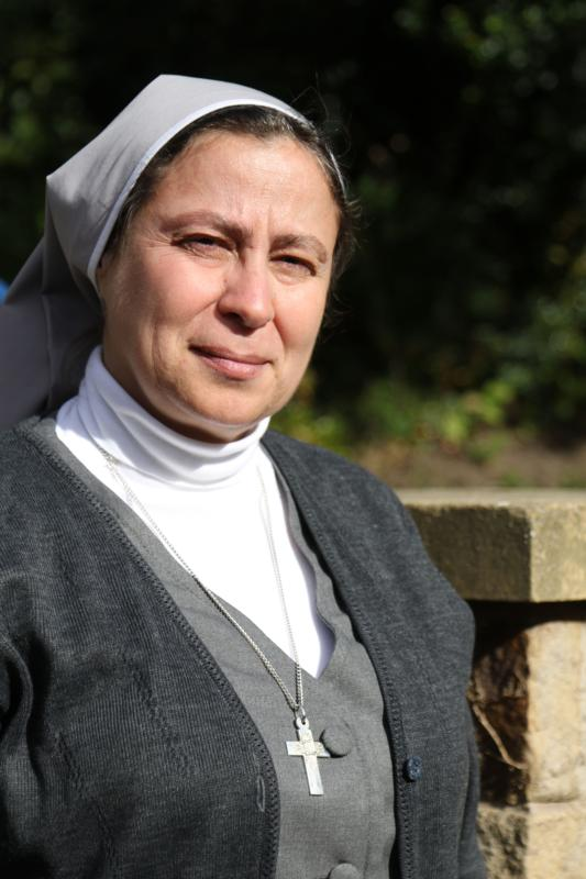 Sister Annie Demerjian, a member of the Sisters of Jesus and Mary who is working with Christian families in Aleppo, Syria, poses for a photo Oct. 10 in Lancaster, England. (CNS photo/Simon Caldwell) See ALEPPO-NUN-COVERAGE Oct. 11, 2016.