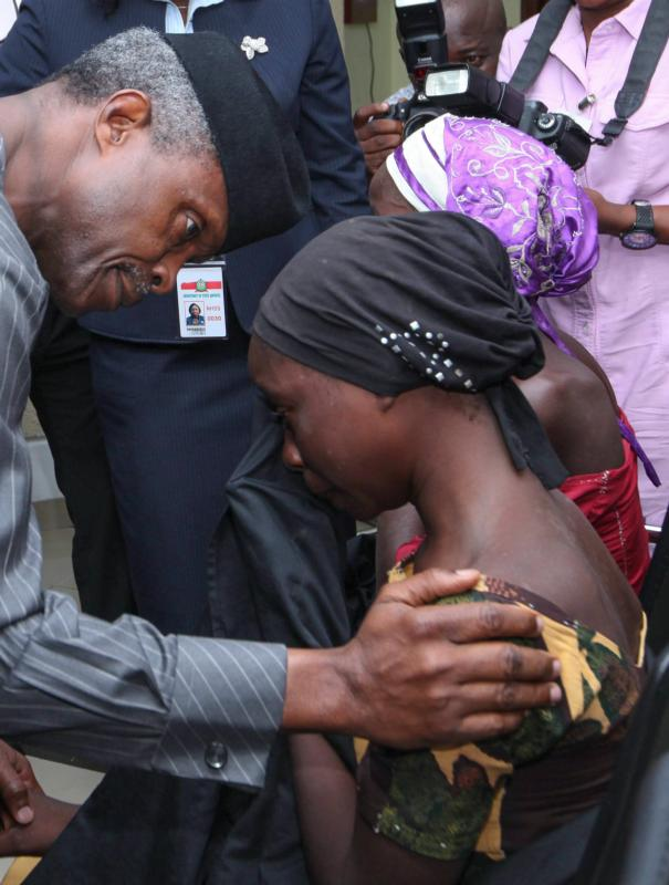 Nigerian Vice President Yemi Osinbajo consoles one of the 21 released Chibok girls Oct. 13 in Abuja. Three Catholic leaders welcomed the release of some of the girls kidnapped in 2014 from a school in Chibok and urged the Nigerian government to prioritize the release of the remaining girls. (CNS photo/EPA) See NIGERIA-CHIBOK-RELEASE Oct. 14, 2016.