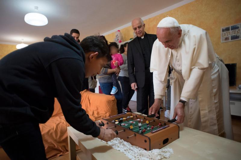 Pope Francis plays table soccer with a young resident during an Oct. 14 visit to Rome's SOS Children's Village. The village, which includes five houses, attempts to provide a home-like atmosphere for children under the age of 12 whose parents cannot care for them. (CNS photo/L'Osservatore Romano) See POPE-MERCY-FRIDAY-CHILDREN Oct. 14, 2016. Editors: The young person's face is distorted to protect his privacy.