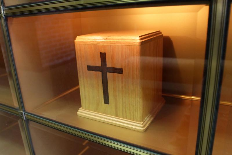 An urn containing cremated remains is seen in a niche in the Holy Rood Cemetery mausoleum in Westbury, N.Y., in 2010. During an Oct. 25 news conference in Rome, Cardinal Gerhard Muller, prefect of the Congregation for the Doctrine of the Faith, said that while the Catholic Church continues to prefer burial in the ground, it accepts cremation as an option, but forbids the scattering of ashes or keeping cremated remains at home. (CNS photo/Gregory A. Shemitz) See VATICAN-LETTER-ASHES Oct. 25, 2016.