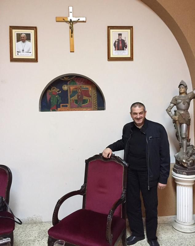 Father Jacques Mourad poses for a photo Nov. 11, 2015 in the reception area at Our Lady of the Annunciation Church in Beirut. The Syriac-Catholic priest, who was held captive by the Islamic State group for nearly five months in 2015, called on Canada to undertake diplomatic steps to end the Syrian civil war. (CNS photo/Doreen Abi Raad) See MOURAD-SYRIA-WORLD Oct. 27, 2016.