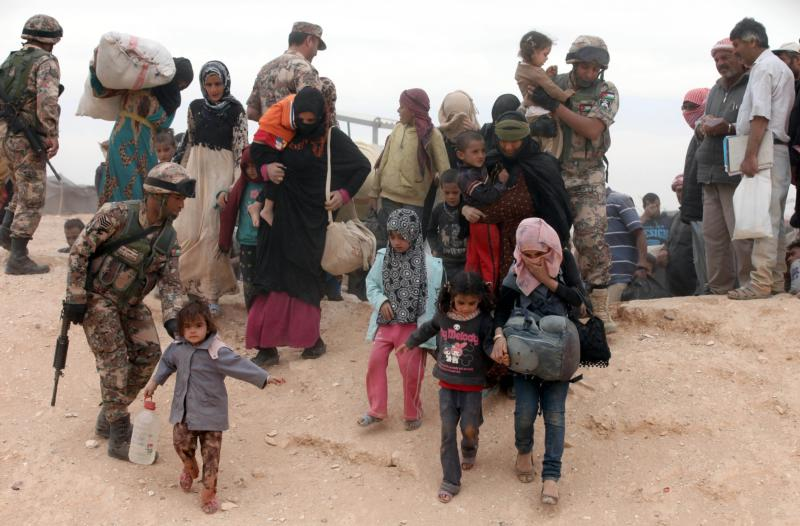 Syrian refugees arrive at a camp after crossing into the Jordanian side of the northeast Jordan-Syria border near Royashed. (CNS photo/Jamal Nasrallah, EPA) See WASHINGTON-LETTER-SYRIA Oct. 28, 2016.