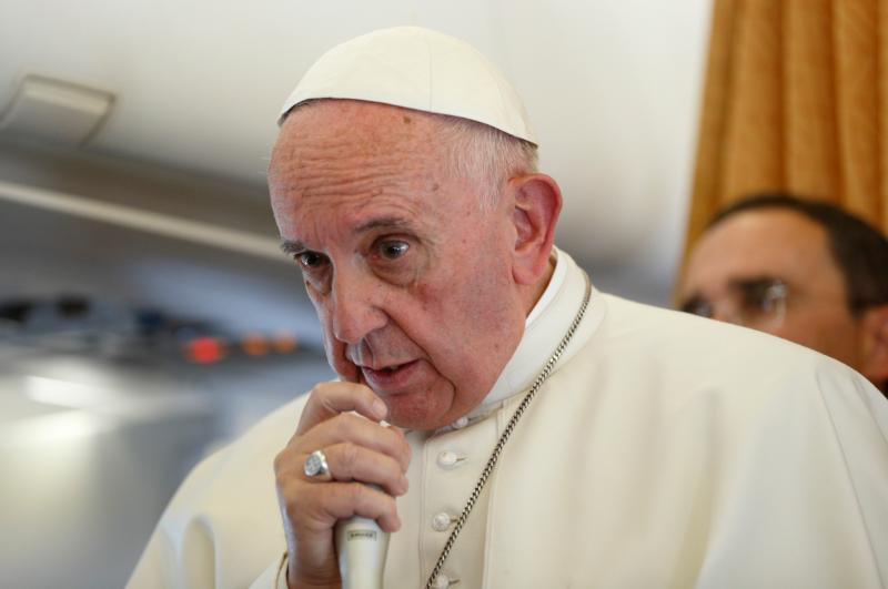 Pope Francis answers questions from journalists aboard his flight from Malmo, Sweden, to Rome Nov. 1. (CNS photo/Paul Haring) See POPE-SWEDEN-PLANE Nov. 1, 2016.