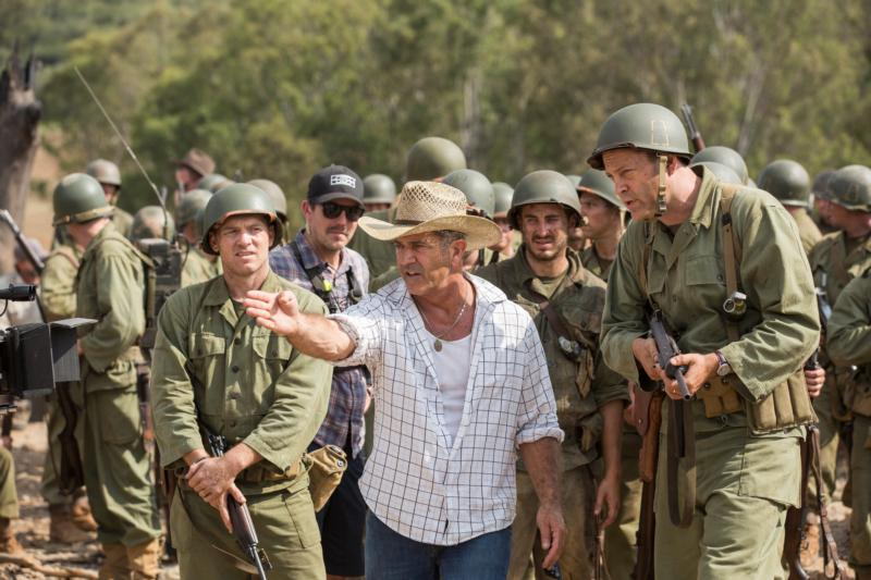 "Director Mel Gibson, center, is seen on the set of ""Hacksaw Ridge."" The movie marks Gibson's return to the director's chair after a 10-year absence. (CNS photo/Lionsgate) See MEDIA-NOTEBOOK-MEL-GIBSON Nov. 4, 2016"