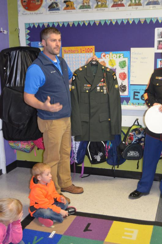 U.S. Army Spec. Joe Holdren explains about his uniform to Jama Budke's class during a Sept. 30 visit to St. John Catholic School in Beloit, Kan. (CNS photo/ courtesy St. John Catholic School) See VETERANS-DAY-PRESCHOOLERS Nov. 7, 2016.
