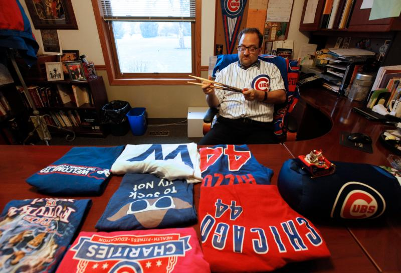 Father Michael Novick, pastor of St. Lawrence O'Toole in Matteson, Ill., shows off his Cubs gear Oct. 27. (Karen Callaway/Catholic New World) See CUBS-FANS-CELEBRATE Nov. 7, 2016.