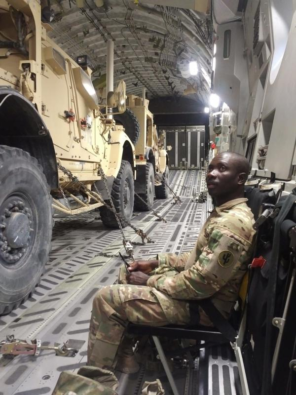 Father Charles Awotwi, a priest of the Diocese of Salina, Kan., is seen aboard a C-17 transport with the U.S. Army in this undated photo. He is currently a military chaplain serving with U.S. troops stationed in the Middle East. (CNS photo/courtesy The Register) See MILITARY-SERVICE-CHAPLAIN Nov. 10, 2016.