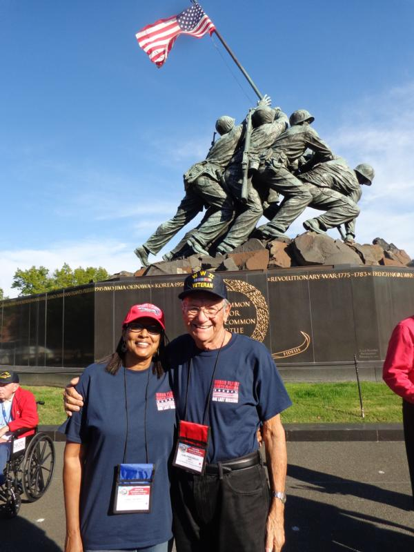 World War II veteran Carl Muscarello of All Saints Parish in Sunrise, Fla., and his guardian, Sandy Thomas, pose Oct. 29 in front of the Iwo Jima Memorial in Arlington, Va., across the Potomac River from Washington. (CNS photo/courtesy The Florida Catholic) See VETERANS-HONORS-FLIGHT Nov. 11, 2016.