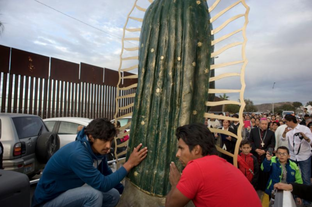 A statue of the Our Lady of Guadalupe is carried in a truck during a procession to the U.S.-Mexico border fence in Tijuana, Mexico, where Mass was celebrated. The Mass and a procession with a statue of Our Lady of Guadalupe were a call to remember and pray for migrants and were led by Archbishop Francisco Moreno Barron of Tijuana. (CNS photo/David Maung)